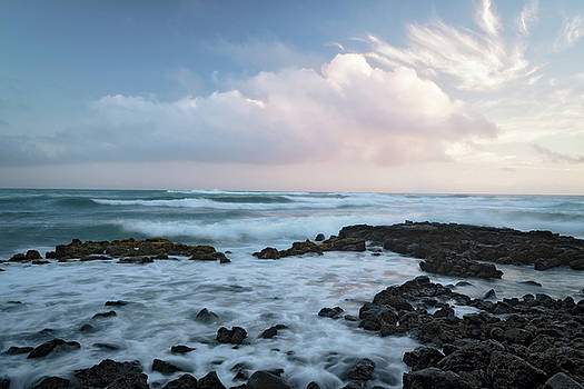 Twilight over the lava tide pools along the South Shore at Poipu. by Larry Geddis