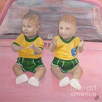 Twins on bonnet by Cybele Chaves