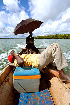 Eduardo Huelin - Two boat men taking a relax time Senegal
