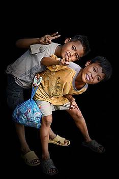 Two Cambodian boys by Mirko Dabic