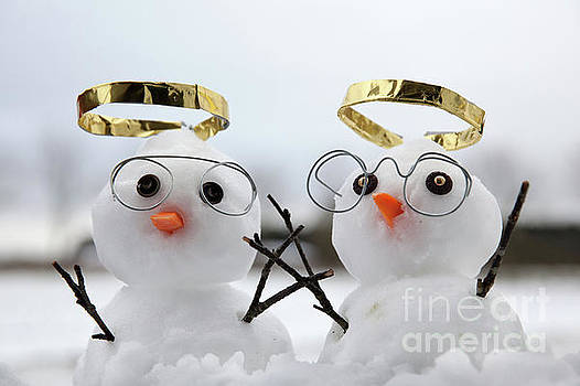 Two cute snowman angles with golden halos by Simon Bratt Photography LRPS