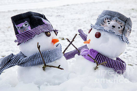 Two cute snowmen friends embracing by Simon Bratt Photography LRPS