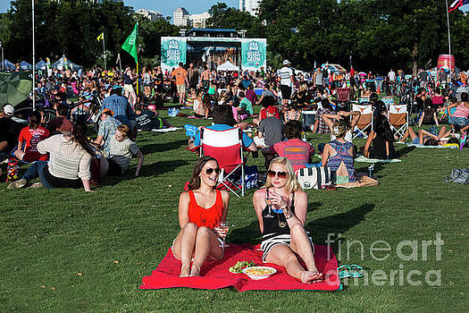 Herronstock Prints - Two female friends enjoying a glass of wine at the Blues On The Green free summertime concerts