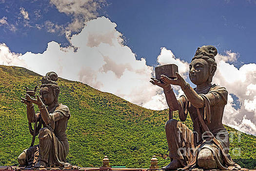 Two of the Six Devas give Offerings to the Tian Tan Buddha by Chris Smith