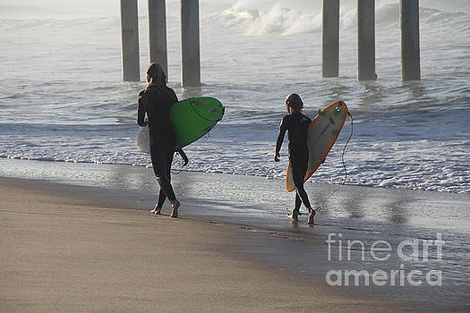 Two Surfers in Step Huntington Beach by Linda Queally
