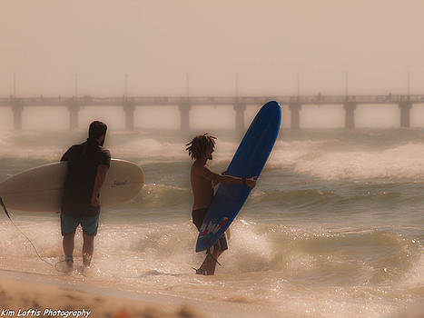 Two surfers by Kim Loftis