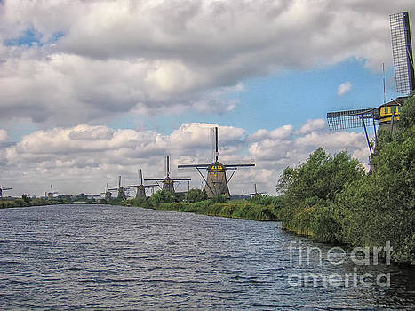 Typical Dutch windmills on a canal by Patricia Hofmeester