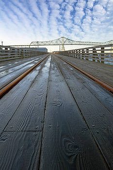 Under Astoria Megler Bridge on Riverwalk by David Gn