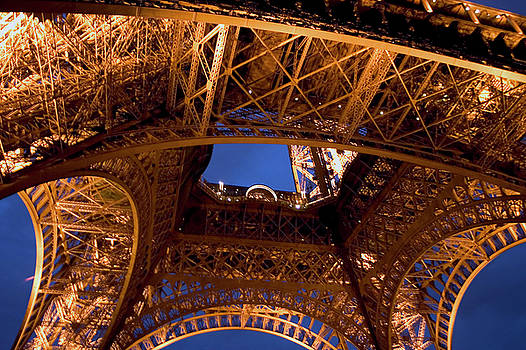 Under Eiffel Tower at Night by Carl Purcell