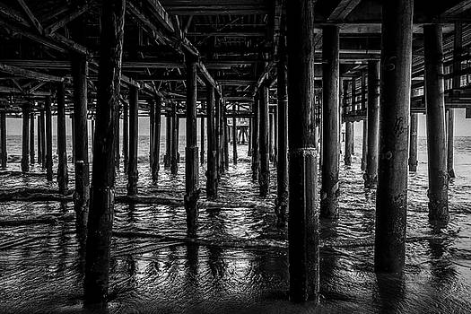 Under The Pier - Black And White by Gene Parks