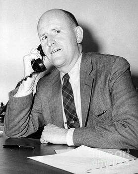 United States Deputy Attorney, Harold Tyler Jr posing for the cam while talking on the phone. 1950 by Anthony Calvacca