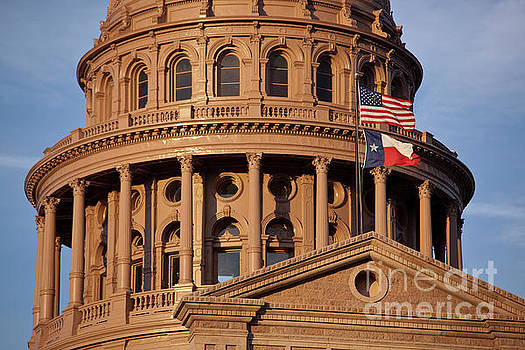Herronstock Prints - United States of America and Texas Flags fly over the majestic Texas State Capital Dome