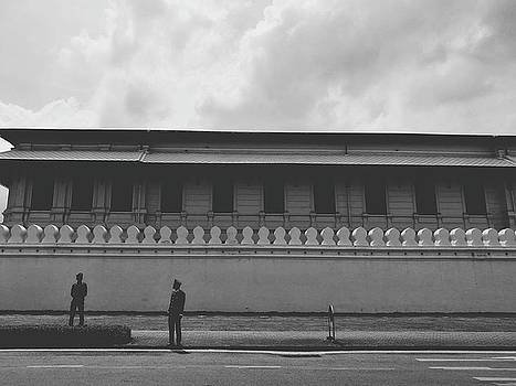 Unknown Men Standing With Long Building Behind Traditional Style Wall  by Sirikorn Techatraibhop