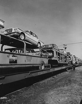 Chicago and North Western Historical Society - Unloading Automobile Cargo From Train - 1960