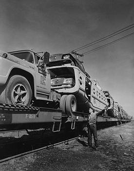 Chicago and North Western Historical Society - Unloading Automobiles From Train - 1960