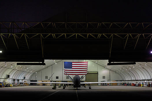US Air Force EQ 4 Global Hawk assigned to the 380th Air Expeditionary Wing await routine Maintenance by Paul Fearn