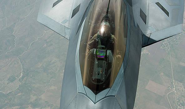 US Airforce F-22 Raptor pilot refuels by Paul Fearn