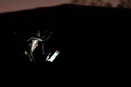 US Marine uses a tablet during a simulated raid of Weapons and Tactics course by Paul Fearn