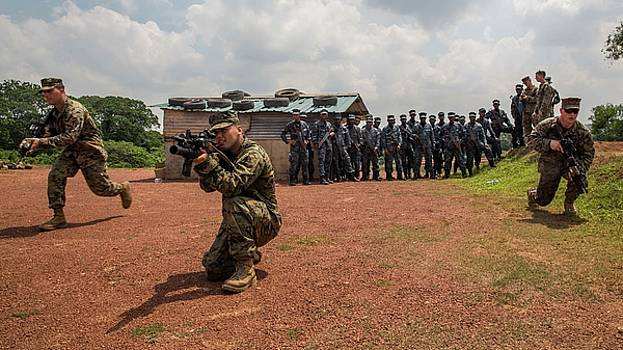 US Marines demonstrate bounding toward an objective as a squad Sri Lanka  by Paul Fearn