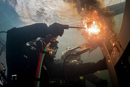 US Navy cuts a piece of steel in a training pool at the Republic of Korea by Paul Fearn