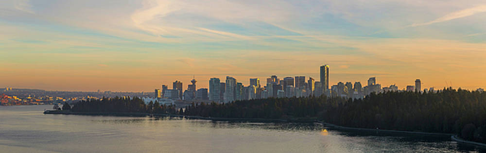 Vancouver BC Skyline Along Stanley Park at Sunset by David Gn