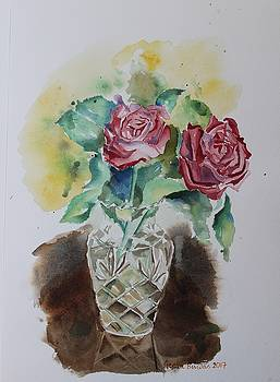 Vase with red roses by Geeta Biswas
