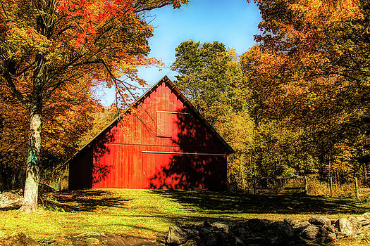 Vermont red barn under fall colors by Jeff Folger