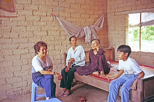 Vietnamese Family In Farmhouse by Rich Walter