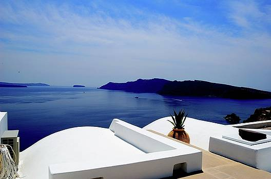 View from the hotel balcony in Santorini by Yuri Hope