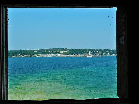 View of Mackinac Island Through the Round Island Lighthouse Window by Mikel Classen