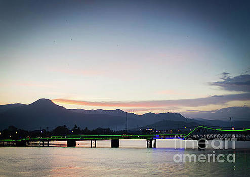 View Of Old Bridge In Kampot Town Cambodia At Sunset by Jacek Malipan