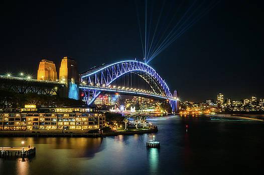 View of Sydney Harbour Bridge illuminated for Vivid by Daniela Constantinescu