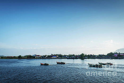 View Of Traditional Fishing Boats On Kampot River In Cambodia by Jacek Malipan