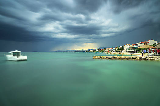 View on adriatic sea coast line before the storm,moving boat,long exposure shot by Andriy Stefanyshyn