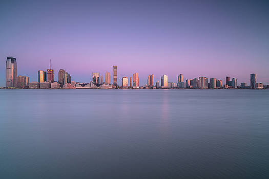 View on Jersey city from water during sunrise  by Andriy Stefanyshyn