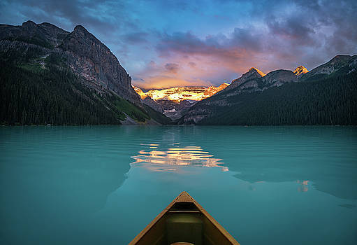 Viewing snowy mountain in rising sun from a canoe by William Freebilly photography