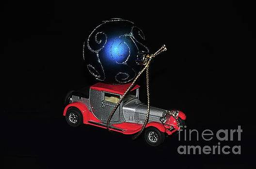Vintage car carrying Christmas ornament by Akshay Thaker- PhotOvation