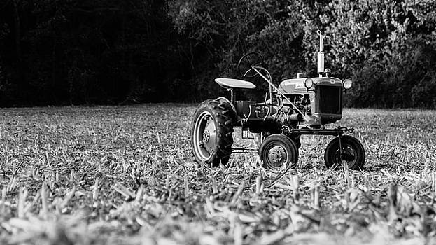 Vintage Farmall in the corn field by Seth Solesbee