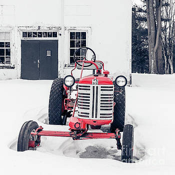 Vintage International Harvester Antique Tractor in the Snow by Edward Fielding