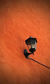 Vintage Lamp On Grunge Brown Wall  by Prasert Chiangsakul