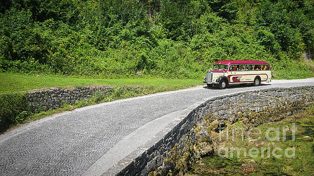 Vintage Mercedes bus on a road by Vyacheslav Isaev