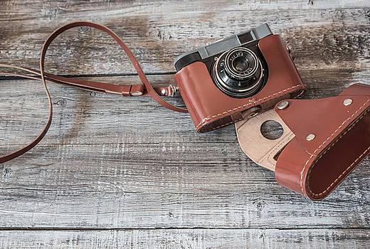 Vintage  old camera on wood background by Julian Popov