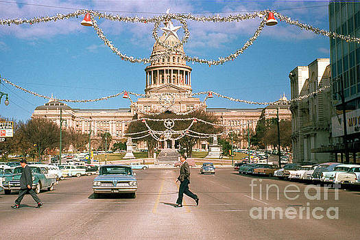 Herronstock Prints - Vintage view of the Texas State Capitol and Christmas decorations strung along Congress Avenue from December 1960
