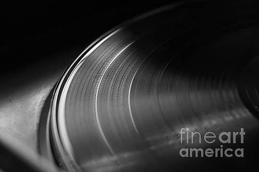 Angelo DeVal - Vinyl record on a turntable. Memory and nostalgia