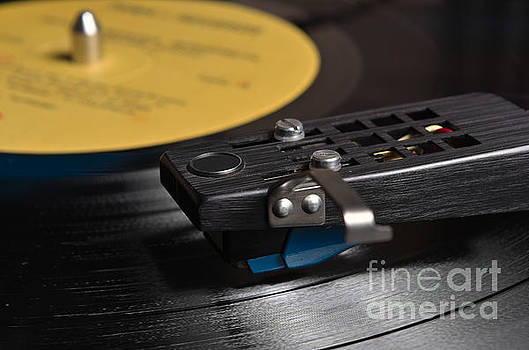 Angelo DeVal - Vinyl record playing on a turntable