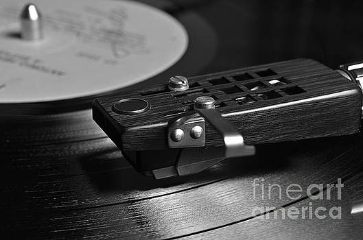 Angelo DeVal - Vinyl record playing on a turntable in Monochrome