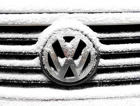 Volkswagen Symbol Under The Snow by Erika H