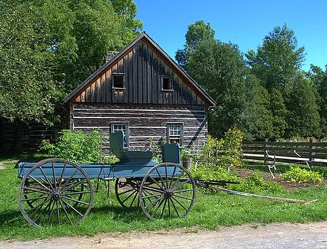 Wagon and Log House by Valerie Kirkwood