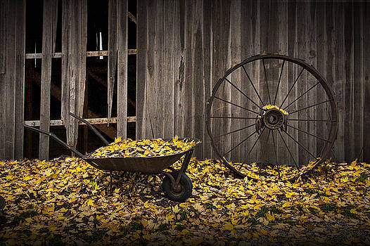 Randall Nyhof - Wagon Wheel Rim and Wheel Barrel covered with Fallen Autumn Leaves
