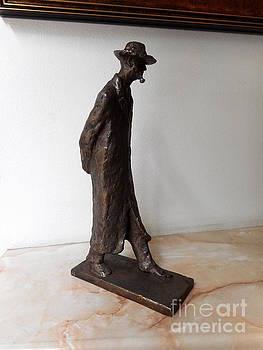 Walking man with a pipe by Nikola Litchkov